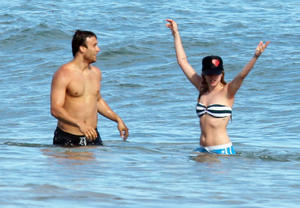 Avril Lavigne nip slip at the beach in Malibu