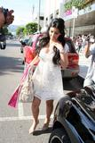 Kim Kardashian shows big cleavage in white dress shopping in Hollywood